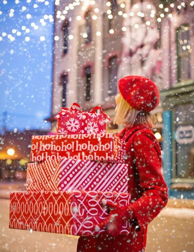 woman-carrying-christmas-presents-3264665